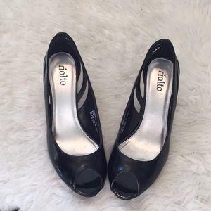NWOT black peep toe heels.